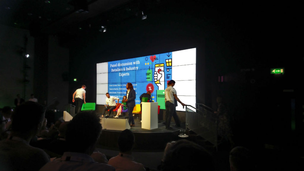 People gathering for the panel discussion on the stage